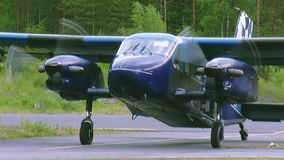 Blue plane for skydivers prepare to take off in air in green woods. Rotate propellers. Flight. stock video footage