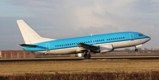 Blue plane taking off stock photos