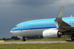 Blue plane taxiing Stock Photo