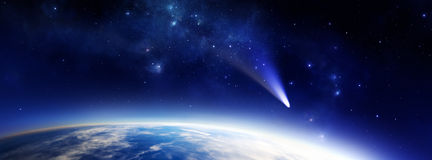 Blue planet with comet. Panorama illustration of a blue Earth like alien planet in space with a comet Stock Image