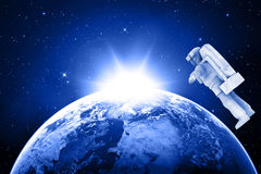Blue planet earth and astronaut Stock Photo