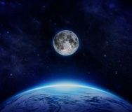 Blue Planet Earth, moon and stars from space on sky Royalty Free Stock Image