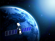 Blue planet earth and satellite in space. With sun lights Royalty Free Stock Image