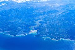 Blue planet Earth seen from high above through an airplane window. Unique panoramic high altitude aerial view of Croatia. Unique aerial view of Croatia Adriatica stock images
