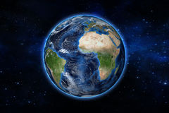 Blue planet earth from space showing America and Africa, USA, globe world with blue glow edge on space in a star field Royalty Free Stock Images