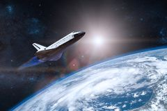 Blue planet Earth. Space shuttle taking off on a mission. Elements of this image furnished by NASA royalty free stock photo