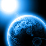 Blue planet earth with sun Royalty Free Stock Photos