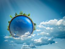 Blue planet floating in the clouds Stock Photography