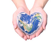 Blue planet in heart shape over woman human hands isolated. On white background: World heart day idea symbolic concept campaign to promote health awareness stock photos