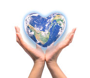 Blue planet in heart shape over woman human hands isolated. On white background: World heart day idea symbolic concept campaign to promote health awareness stock photo