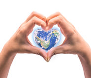 Blue planet in heart shape over woman human hands isolated. On white background: World heart day idea symbolic concept campaign to promote health awareness stock photography