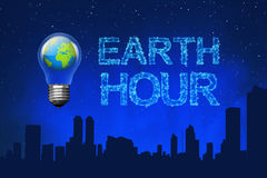 Blue planet on light bulb with Earth Hour message. On the sky Stock Images