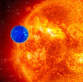 Blue Planet And Red Sun. Small Blue Planet And Large Red Sun, Space Background Royalty Free Stock Image