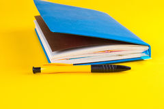 Daily planner with colored bookmarks. Blue Daily planner with colored bookmarks. yellow background Royalty Free Stock Photos