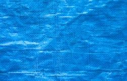 Blue plastic background. Blue wrinkled plastic sheet background Royalty Free Stock Photo