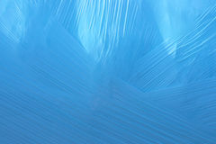 Blue plastic background. Close-up of blue plastic foil used to cover hay and straw bails in England royalty free stock image