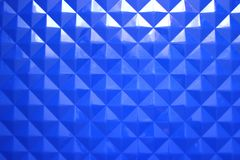 Blue plastic background with geometric shapes stock images