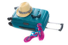 Blue plastic bag, straw hat, sunglasses and beach shales Stock Photos