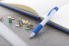 Blue plastic ball pen with office supplies royalty free stock image