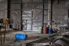 Blue Plastic Barrel on Floor Surrounded by Metal Pipe Inside Warehouse Stock Images