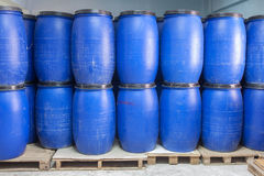 Blue Plastic barrels contain chemical inside. Stack on palette Royalty Free Stock Images