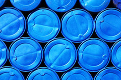 Blue plastic barrels containing chemicals Stock Photos