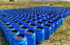 The blue plastic barrels for storage of chemicals Stock Photography