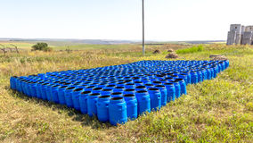 The blue plastic barrels for storage of chemicals Royalty Free Stock Image
