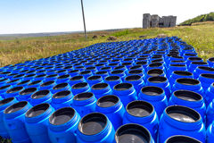 The blue plastic barrels for storage of chemicals Royalty Free Stock Photography