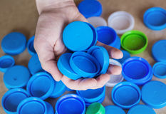 Blue plastic bottle caps Stock Photos