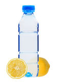 Blue plastic bottle of water and lemon isolated on white Royalty Free Stock Images