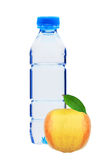 Blue plastic bottle of water and yellow apple isolated on white Stock Photography
