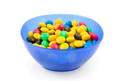 Blue plastic bowl with chocolate candy Stock Images