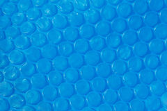 Blue plastic bubble wrap texture. Royalty Free Stock Images