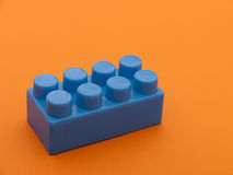 Blue plastic building brick Royalty Free Stock Photography