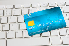 Credit card on keyboard stock photography
