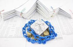 Blue plastic chain shackle gift box and pile gold coins Royalty Free Stock Images