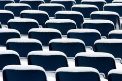 Blue plastic chairs covered in snow Stock Image