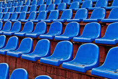 Blue plastic chairs on  football tribune Stock Images