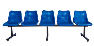 Blue plastic chairs isolated on white Royalty Free Stock Photo