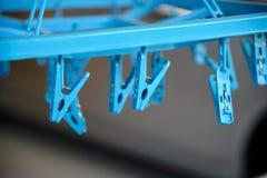 Blue plastic clothespin Stock Photos