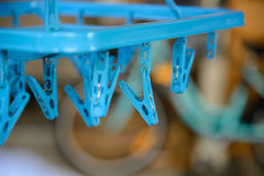 Blue plastic clothespin Stock Photography