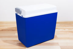 Blue plastic container on a floor Royalty Free Stock Images