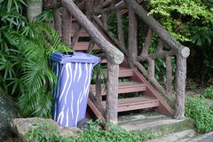 Blue Plastic Container or Recycle Bin near Old Stairs. In The Park royalty free stock image