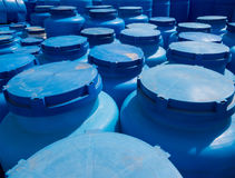 Blue plastic containers for storage of liquids in the storage area Royalty Free Stock Photo
