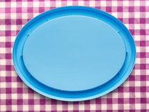 Blue plastic cover on checked background Stock Photo