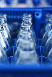Blue Plastic Crate with Glass Bottles Stock Photo