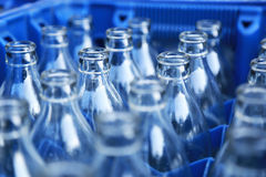 Blue Plastic Crate with Glass Bottles Royalty Free Stock Photography