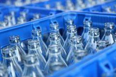 Blue Plastic Crate with Glass Bottles Royalty Free Stock Photos