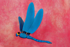 Blue plastic dragonfly Royalty Free Stock Photo